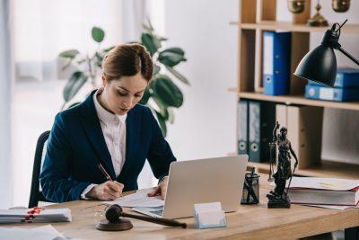 estate planning lawyer sitting at desk writing