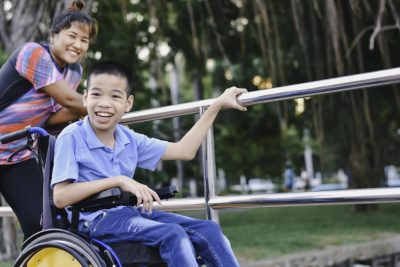 estate planning for disabled beneficiary   parent pushing child in wheelchair