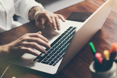 digital estate planning - man typing on laptop