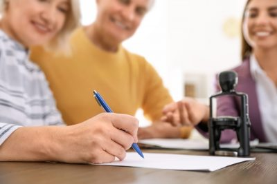 older couple signing a will