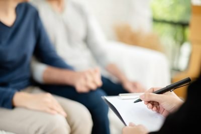 couple sitting with estate planning lawyer | commonly overlooked estate planning items
