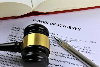 power of attorney document with gavel and pen
