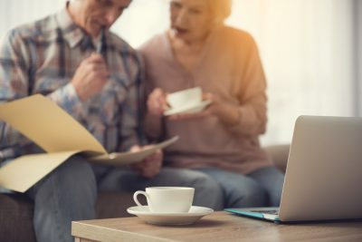 couple looking at paperwork to update their will